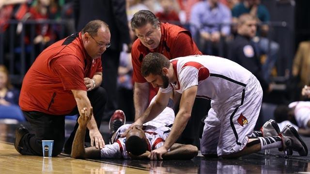Luke Hancock comforts Kevin Ware